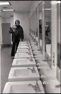 Thumbnail of Richard Safft in bathroom at JFK airport