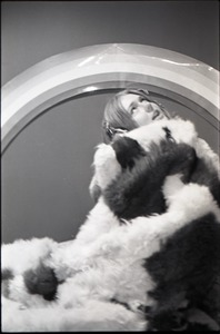Thumbnail of Lynn Smith wrapped in faux fur blanket, modeling Koss headphones