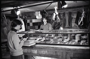 Thumbnail of Don Muller with customer at the counter in the Leather Shed