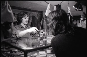 Thumbnail of Don Muller with a customer at the counter, the Leather Shed