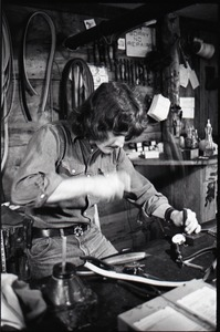 Thumbnail of Don Muller working at his bench, the Leather Shed