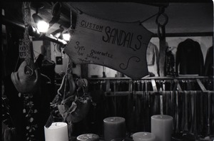 Thumbnail of Sign advertising sandles for sale above candle display, the Leather Shed