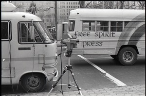 Thumbnail of Free Spirit Press bus and Channel 5 news van parked, camera nearby, during interview by Channel 5 news