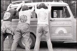 Thumbnail of Three members of the Brotherhood of the Spirit Community feigning arrest,             wearing Spirit in Flesh t-shirts and leaning against the Free Spirit Press van