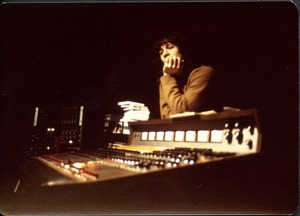 Thumbnail of Jimmy Skiathitis leaning on the mixing board in the recording studio