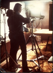 Thumbnail of Jim Baker working a video camera in studio
