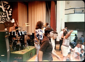 Thumbnail of Rapunzel concert, on stage at local school(?): kids on stage with the band