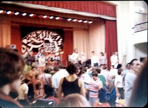 Thumbnail of Rapunzel concert, on stage at local school(?): band and audience