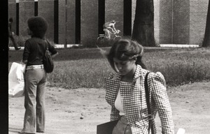 Thumbnail of Students walking past the library tower