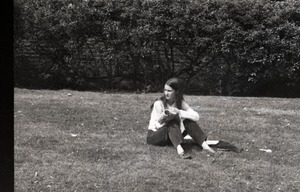 Thumbnail of Young woman seated on a lawn
