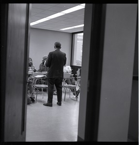 Thumbnail of View through an open door of a class is session, UMass Amherst