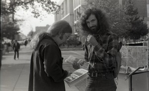 Thumbnail of Free Spirit Press crew member distributing copies of the magazine, possibly in             Springfield