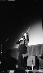 Thumbnail of Unidentified band in performance in what appears to be a high school gymnasium:             violinist