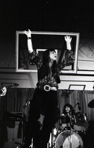 Thumbnail of Unidentified band in performance in what appears to be a high school gymnasium:             lead singer