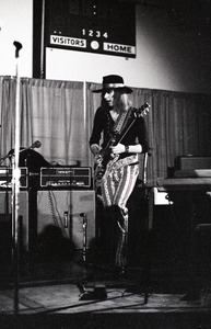 Thumbnail of Unidentified band in performance in what appears to be a high school gymnasium:             lead guitarist