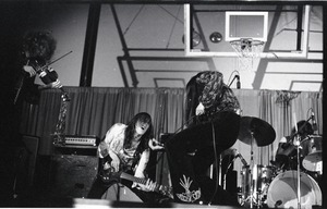 Thumbnail of Unidentified band in performance in what appears to be a high school gymnasium