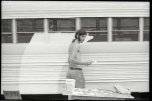 Thumbnail of Bill Grabin painting the Free Spirit Press bus