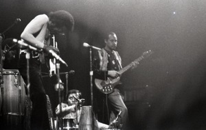 Thumbnail of Miles Davis in performance: Miles Davis (trumpet), Badal Roy (tabla), Khalil             Balakrishna (electric sitar)
