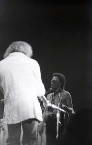Thumbnail of Miles Davis in performance: Miles Davis with trumpet