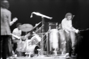 Thumbnail of Miles Davis in performance: band in action (blurred)