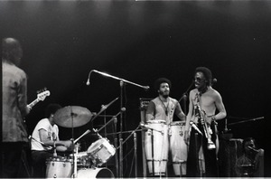 Thumbnail of Miles Davis in performance: band with James Mtume (congas) and Miles Davis