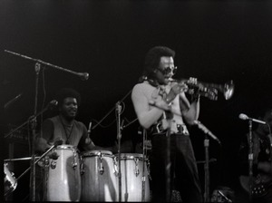 Thumbnail of Miles Davis in performance: James Mtume (congas) and Miles Davis (trumpet)
