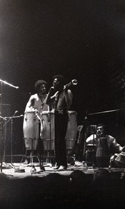 Thumbnail of Miles Davis in performance: James Mtume (congas), MIles Davis (trumpet), and Badal Roy             (tabla)