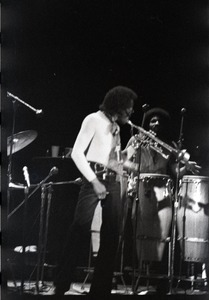 Thumbnail of Miles Davis in performance: Davis (trumpet) and James Mtume (congas)