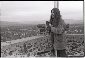 Thumbnail of Bruce Geisler at Poets Seat Tower, looking over the town of Greenfield