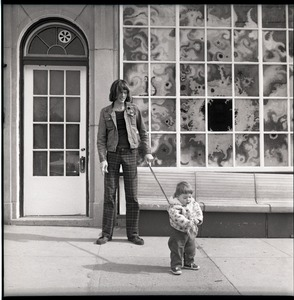 Thumbnail of Mark Holland with daughter Lamia on a leash
