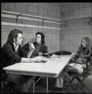 Thumbnail of Bob Weir sitting at table with Mitch Sieser and Anne Baker (l. to r.)