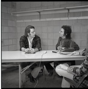 Thumbnail of Bob Weir sitting at table with Mitch Sieser (l. to r.)