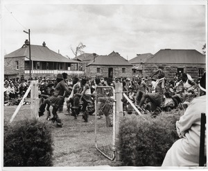 Thumbnail of Group of men dancing in front of a crowd