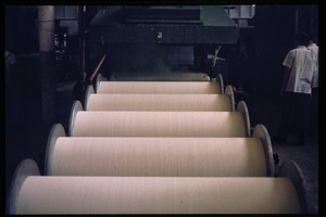 Thumbnail of Cotton mill: large spools of fine cotton yarn