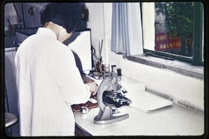 Thumbnail of Shanghai Academy of Agricultural Sciences: woman in a laboratory with microscope