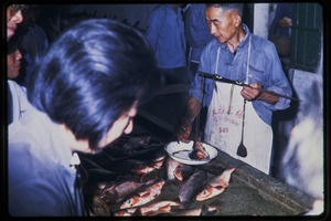 Thumbnail of Fish vendor at market