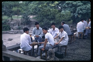 Thumbnail of Men gathering in garden at Tiger Hill Pagoda