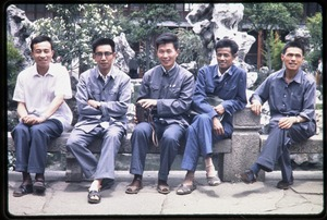 Thumbnail of Group of men seated in rock garden (probably at Tiger Hill Pagoda)
