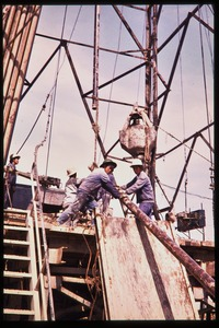 Thumbnail of Woman oil workers on a drilling rig