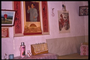 Thumbnail of Wall decorated with posters of Mao and others, probably in a residence for oil workers