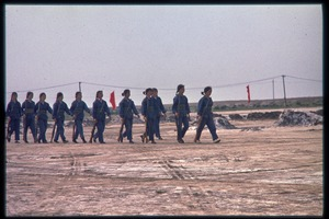 Thumbnail of Women taking part in military training: marching with rifles
