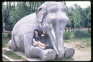 Thumbnail of Visit to the Ming Tombs: Science for the People member posed on sculpture of an elephant