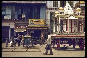 Thumbnail of Street scene, with rickshaw business and cart used for processions