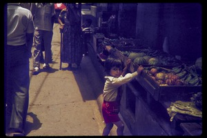 Thumbnail of Street scene, with child next to fruit stand