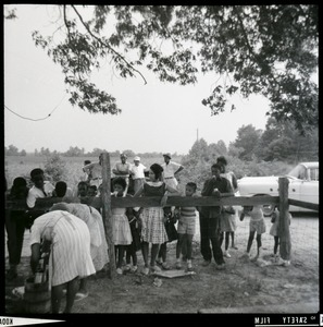 Thumbnail of Group of African American children standing by a fence