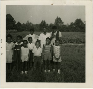 Thumbnail of Freedom School students gathered by cotton field outside the school