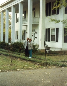 Thumbnail of Wil Colom and Charleana Hill Cobb, outside Colom's house