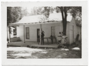 Thumbnail of Children standing by a ping pong table on porch of Rust Avenue             house rented by the Congress of Federated Organizations (COFO)