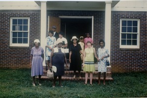 Thumbnail of Marjorie Merrill (2d from right) and church members at rebuilt Antioch Church,             Blue Mountain, Miss.