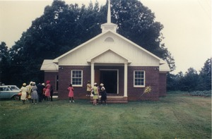 Thumbnail of Church members in front of rebuilt Antioch Church, Blue Mountain, Miss.